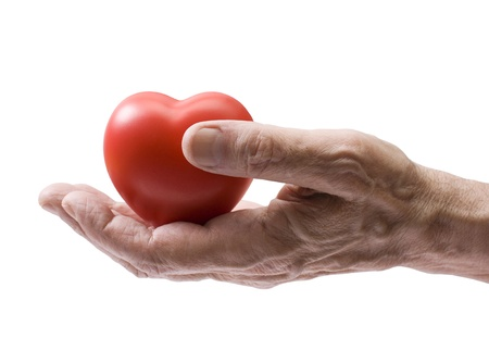 Old hand with red heart