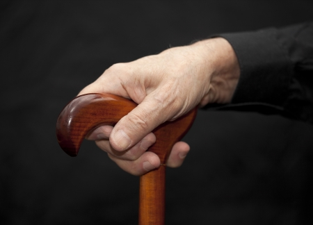 arthritic: Old man with walking stick