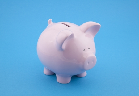 Piggy bank on blue background Stock Photo - 16259545