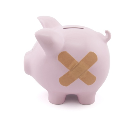 Piggy bank with plaster Stock Photo - 16259363