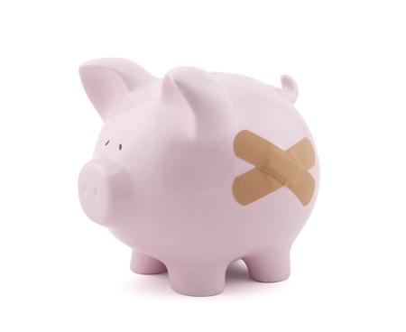 Piggy bank with plaster  Stock Photo - 16259299