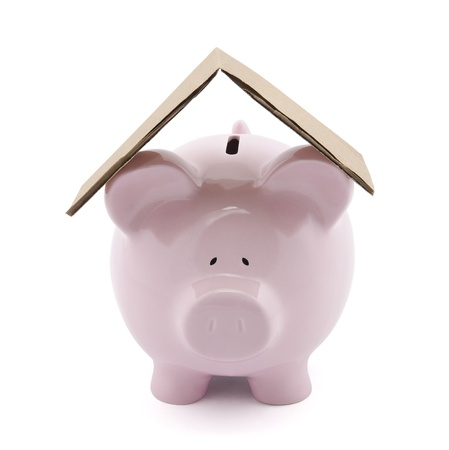 Piggy bank with cardboard roof   Stock Photo - 16259190