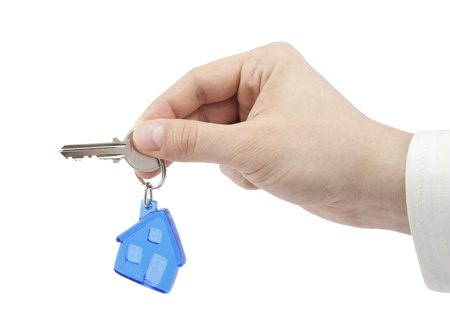 housing: House key in hand  Stock Photo