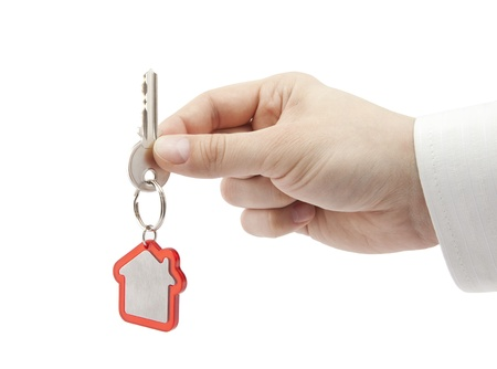 real estate investment: House key in hand  Stock Photo