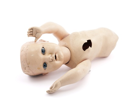 Abandoned child s baby doll with clipping path