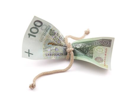 Polish money tied in twine with clipping path