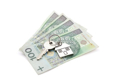 House key on pile of polish banknotes with clipping path photo