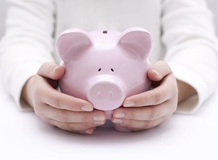 cuenta bancaria: Hucha protegido por las manos
