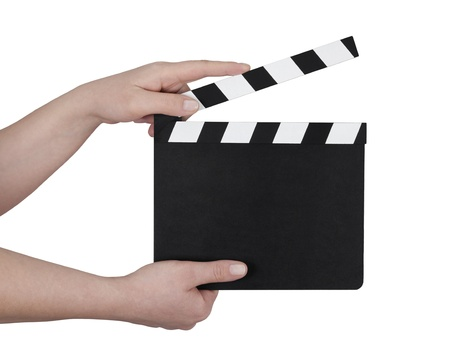 Hands holding a film clapperboard with clipping path Imagens