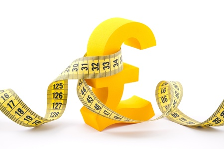 Golden pound symbol with measuring tape Stock Photo - 19089122