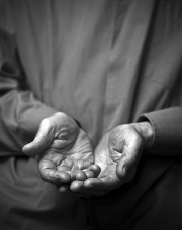 pauper: Poverty  Wrinkled empty old hands Stock Photo