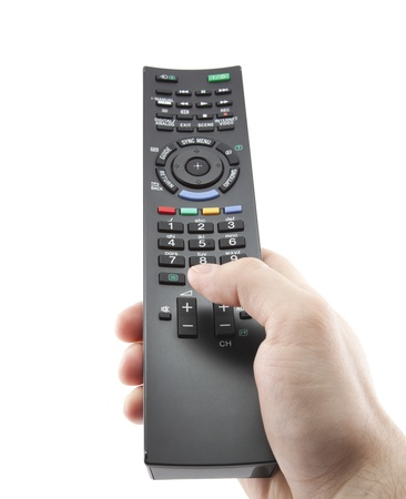 television remote: Hand pressing remote control with clipping path Stock Photo