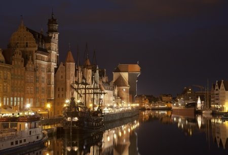 caravel: The medieval port crane in Gdansk at night, Poland