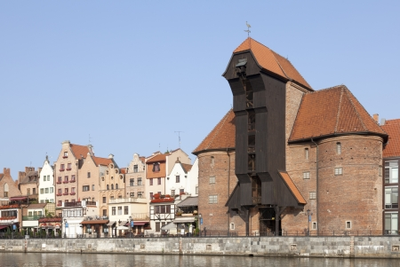 The medieval port crane over Motlawa river in Gdansk, Poland photo