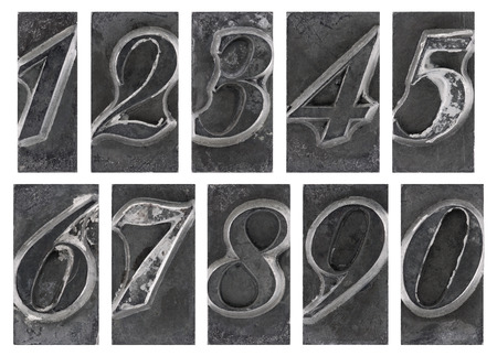 Old metal type numbers isolated on white photo