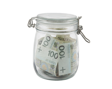 Polish money in a glass jar with clipping path photo