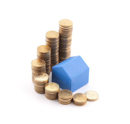 Blue house with stack of coins photo