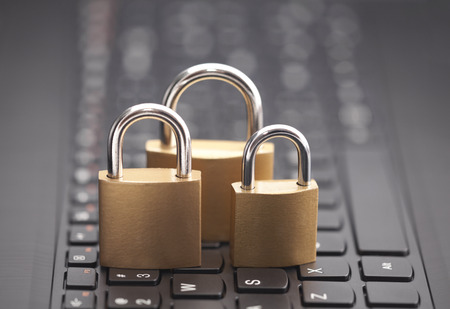 Internet security concept with padlocks on laptop keyboard Stock Photo