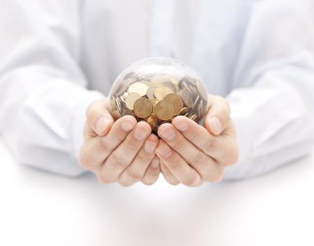 cash money: Bola de cristal con el dinero en las manos Foto de archivo