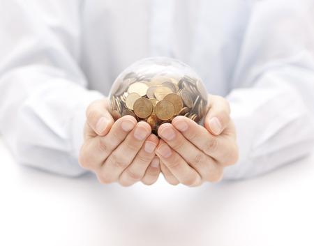 man holding money: Crystal ball with money in hands