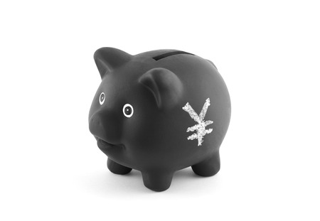 yen sign: Black piggy bank with yen sign