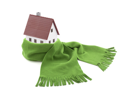 protect home: House wrapped in a scarf isolated on white Stock Photo