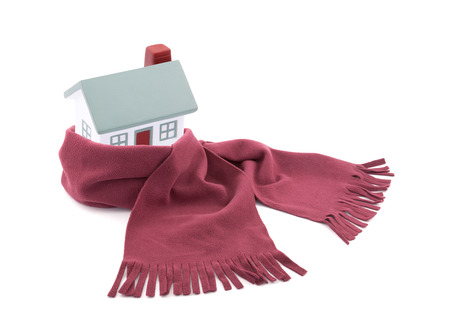House wrapped in a scarf isolated on white Standard-Bild