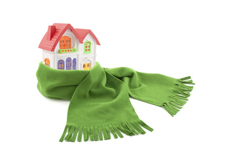 economizing: House wrapped in a scarf isolated on white Stock Photo