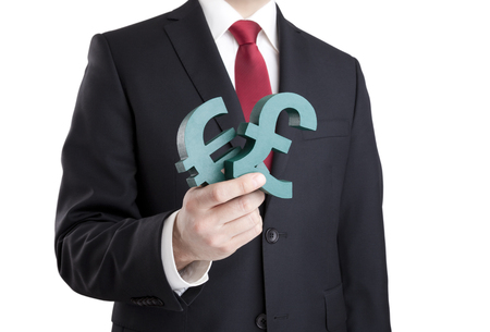 eurozone: Businessman holding euro and pound signs with clipping path