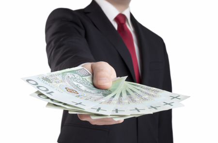 Businessman holding polish money. Clipping path included.