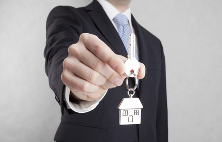 House key in businessman hand