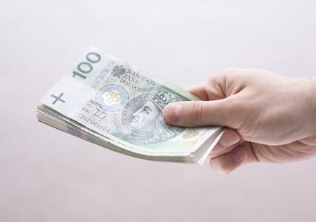Polish money in hand Foto de archivo