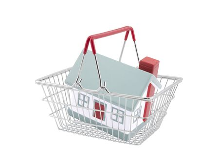 sold small: Shopping basket with house miniature isolated on white background
