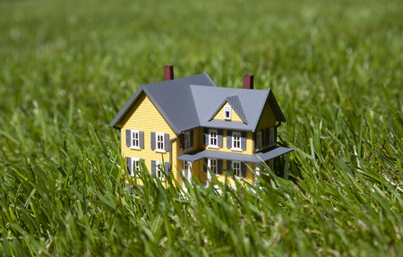 yellow house: Small yellow house on green grass