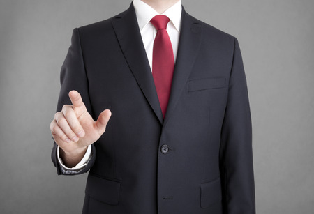 red hand: Businessman pointing or touching something