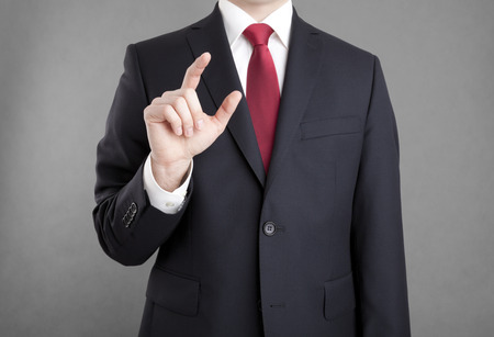 Businessman touching or holding something Stock Photo