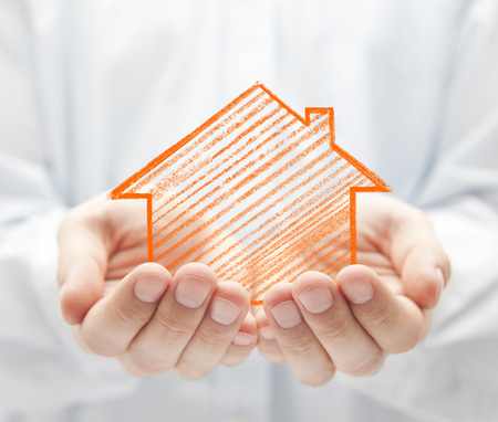 assure: Drawing house in hands Stock Photo