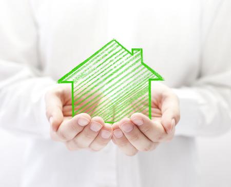 Tekening huis in handen