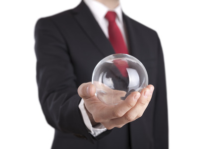 Businessman holding a glass ball isolated on white. Clipping path included.