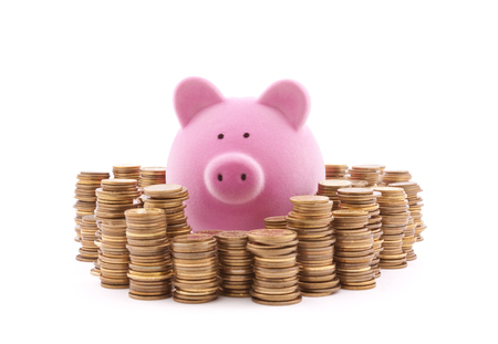 path to wealth: Piggy bank with stacks of coins. Clipping path included. Stock Photo
