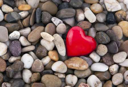 pebbles: Red heart on pebbles background