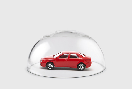 car glass: Red car protected under a glass dome
