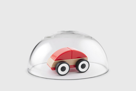 red sphere: Red toy car protected under a glass dome