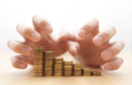 greed: Greed for money. Hands grabbing coins.