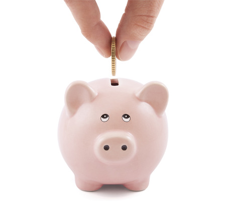 putting: Putting coin into the piggy bank Stock Photo