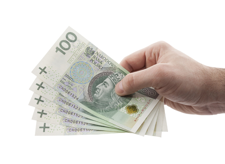 male hand: Polish money in hand with clipping path