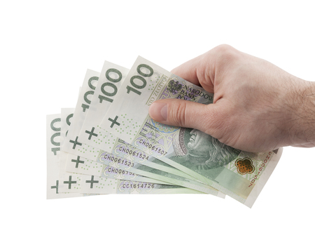 polish: Polish money in hand with clipping path