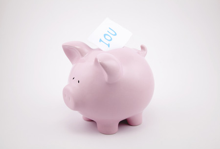 obligated: Pink piggy bank and blank sheet of paper with copy space for text message