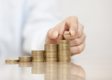 Rising stack of coins Stock Photo