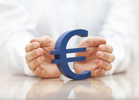 currencies: Euro sign protected by hands